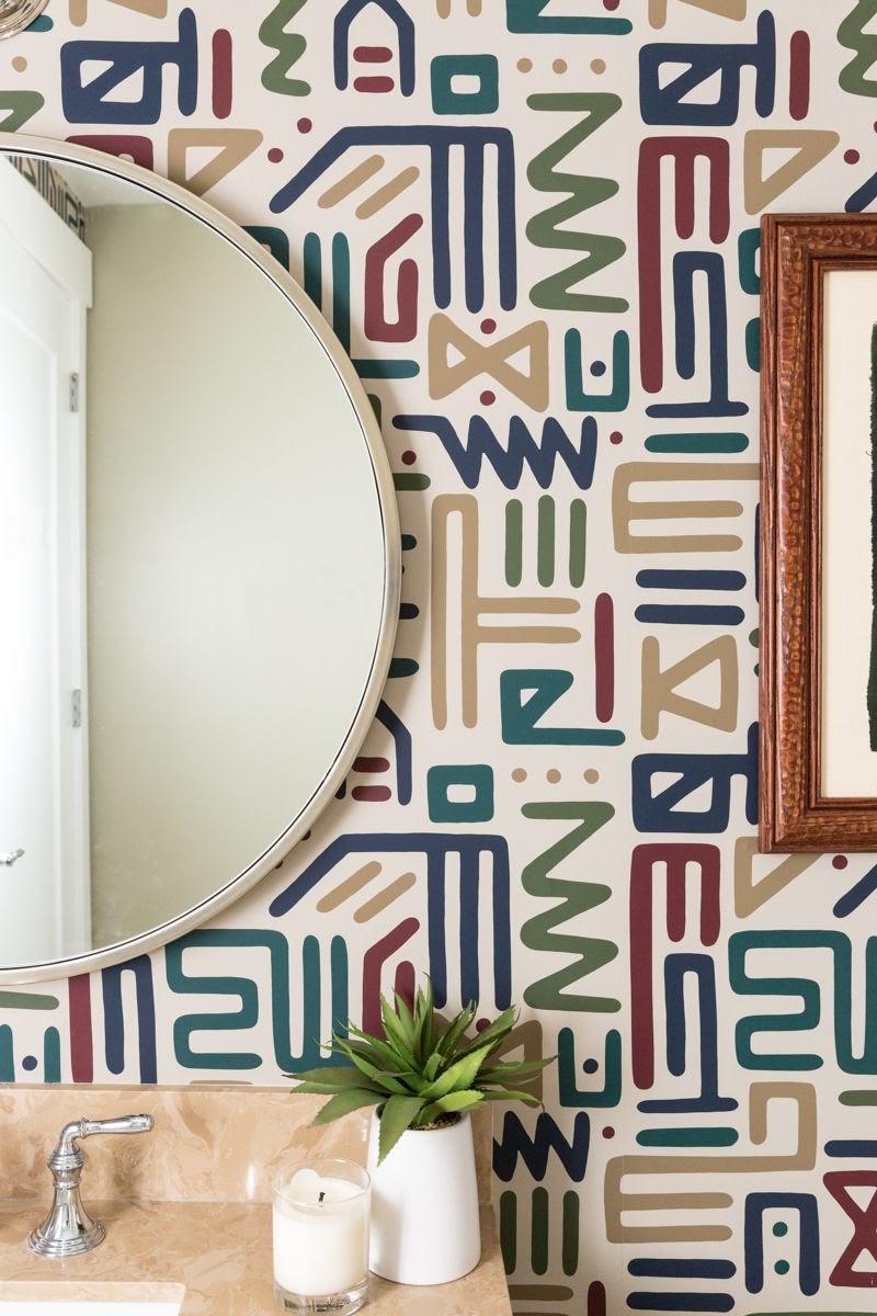 walnut creek powder room fun geometric wallpaper mirror vanity blue green yellow red