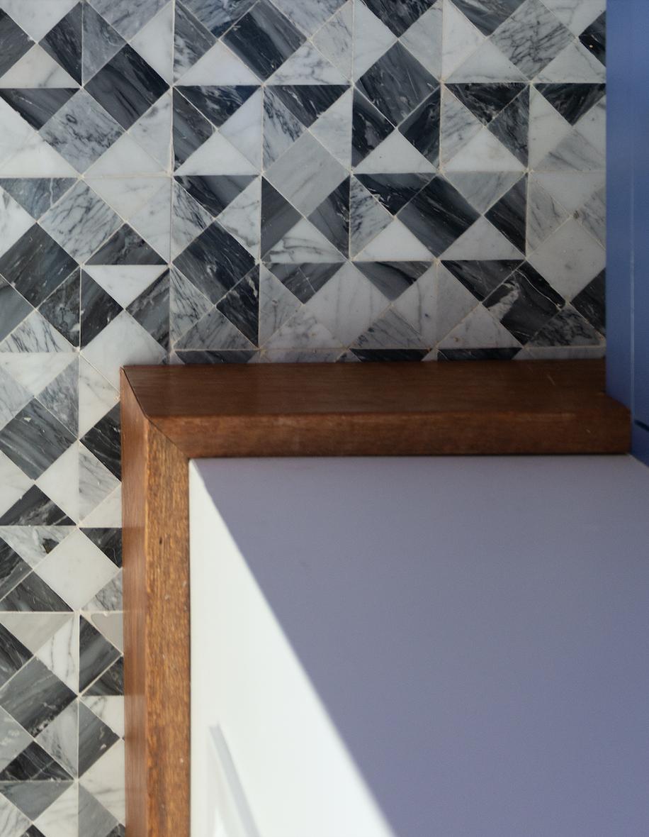 marble tile flooring black white gray geometric squares triangles bathroom renovation piedmont