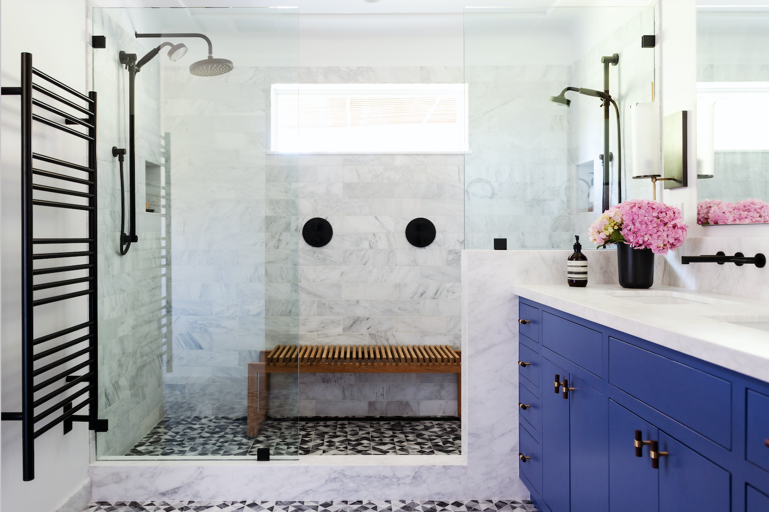 after bathroom remodel marble geometric tile blue vanity spa-inspired walk-in shower joy street