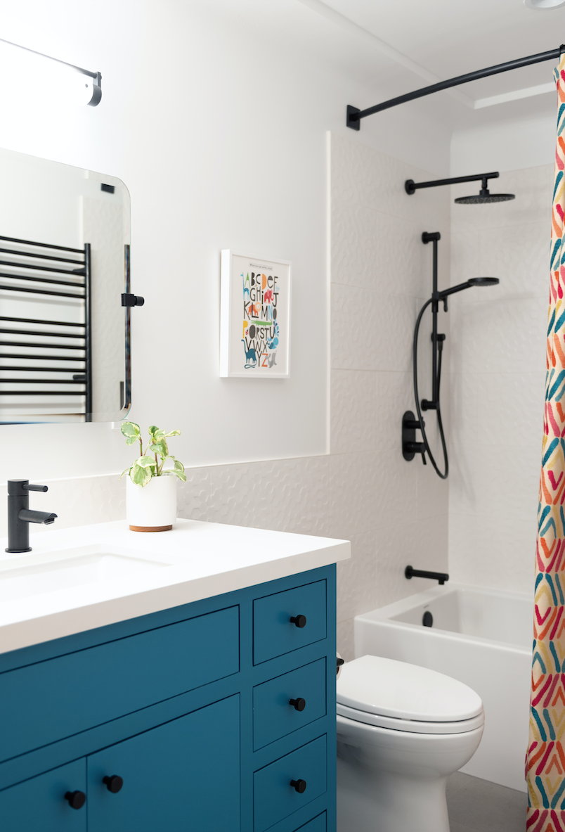after kids bathroom redesign blue vanity tile walls easy cleaning bright joyful family of 7