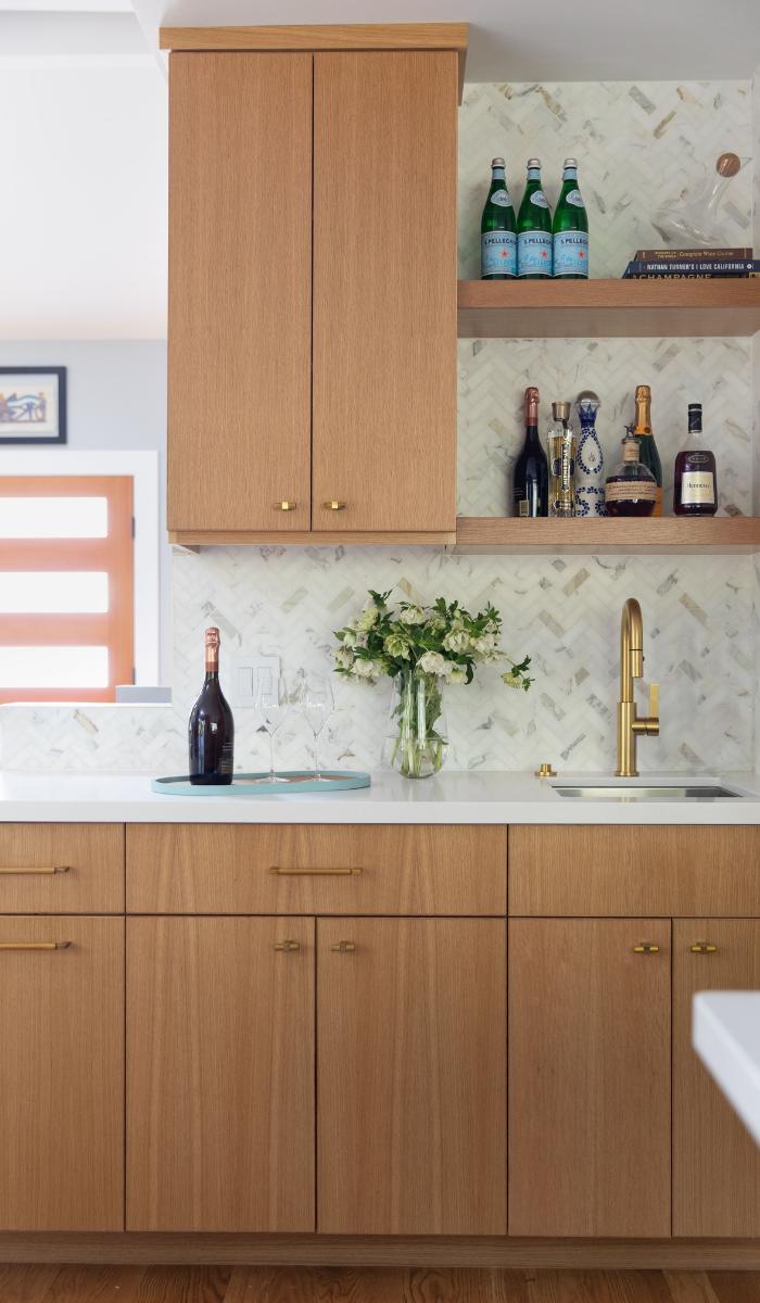 1940s kitchen remodel wet bar tile backsplash open shelving brass faucet