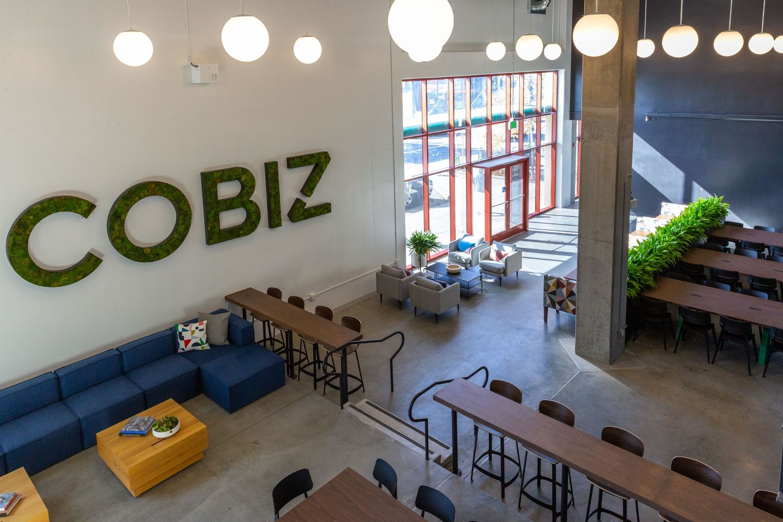 cobiz view from above modern lighting greenery sign colorful seating