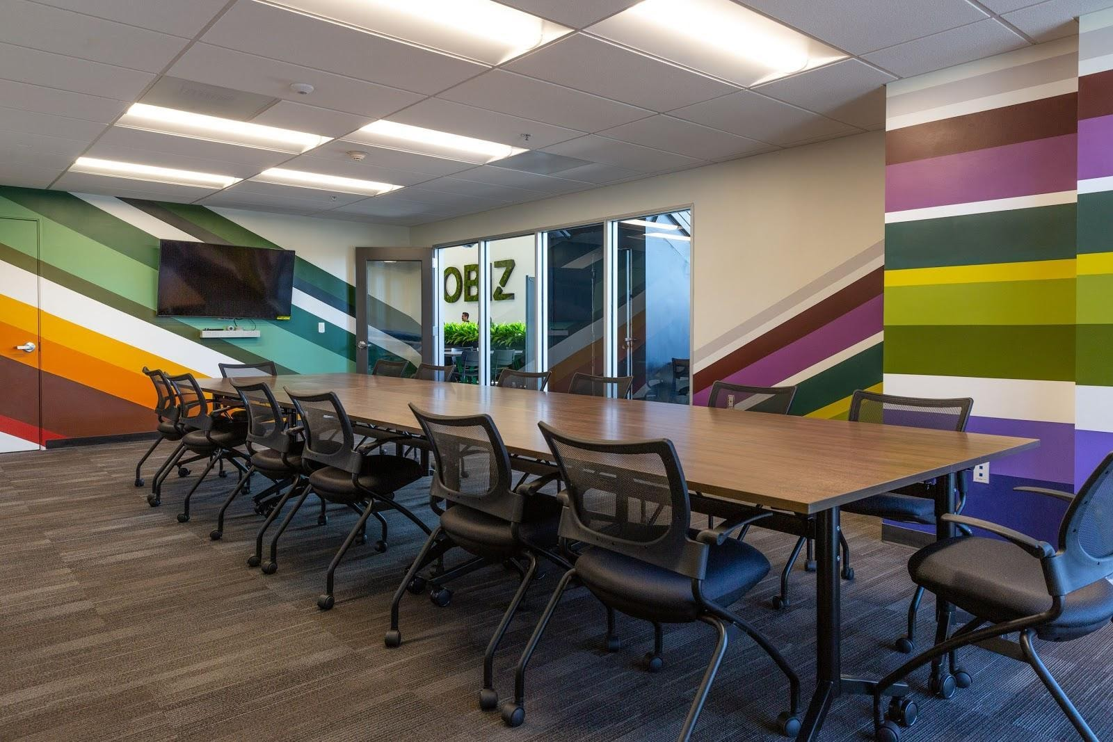 creative conference room design colorful painted mural orange green purple