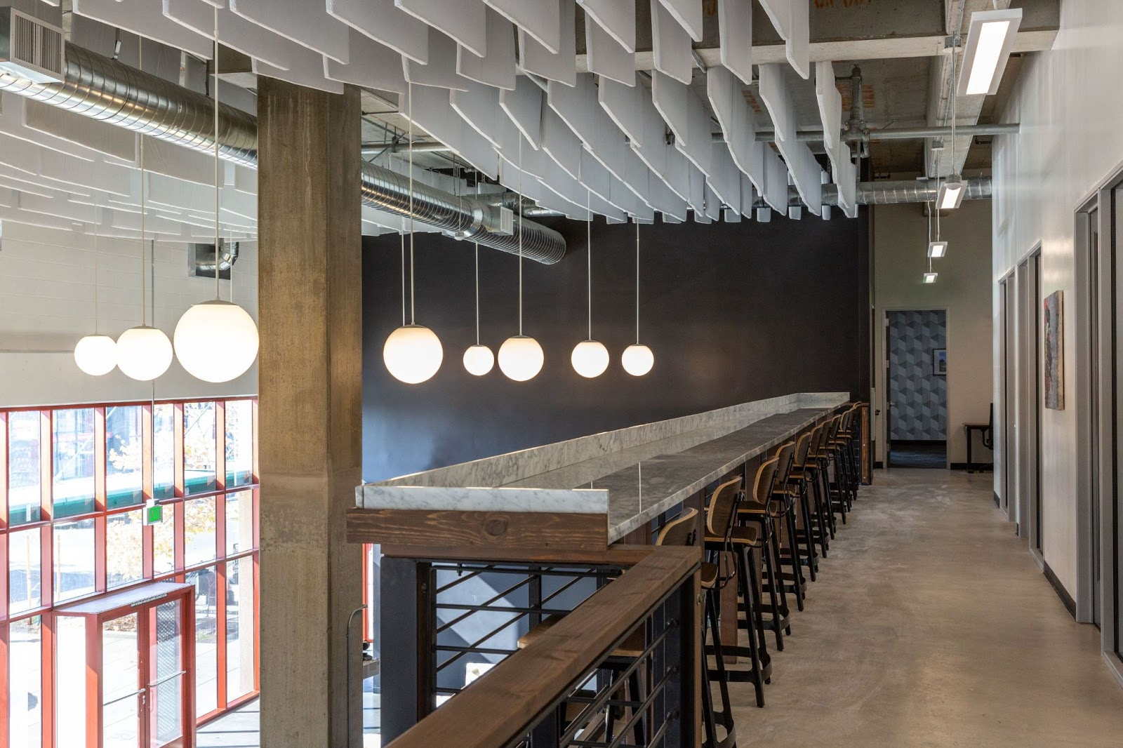 cobiz coworking space modern lighting bar seating upstairs conference rooms
