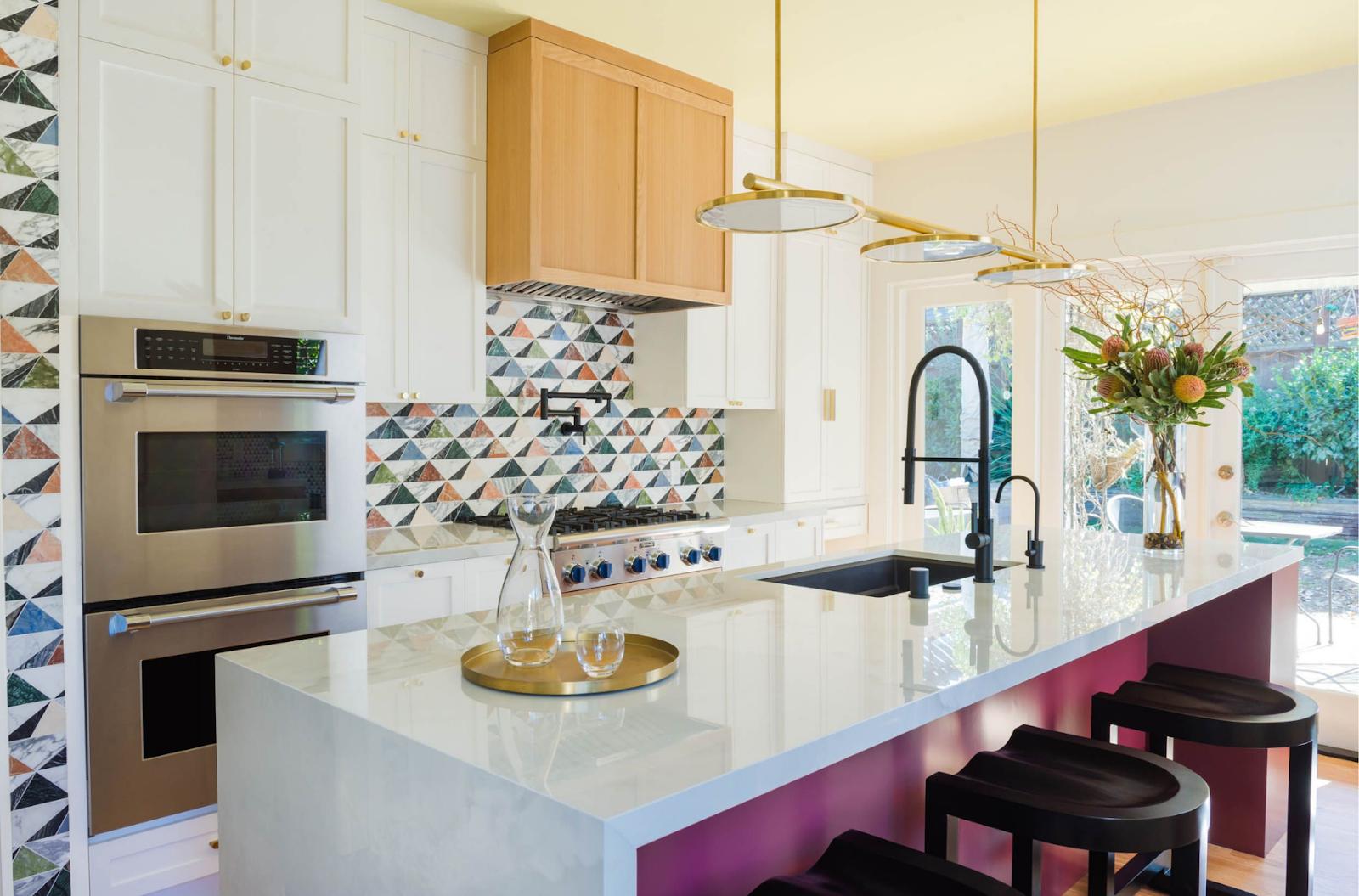 joy street design kitchen after magenta island waterfall countertop brass pendants geometric tile