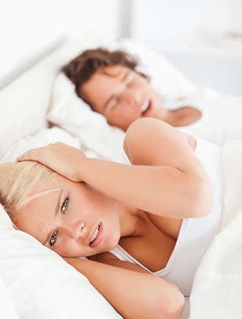 Woman suffering restless night due to partner's snoring