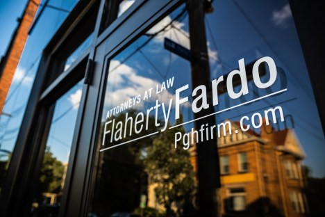 A photo of the outside of the Flaherty Fardo office with their logo on the window