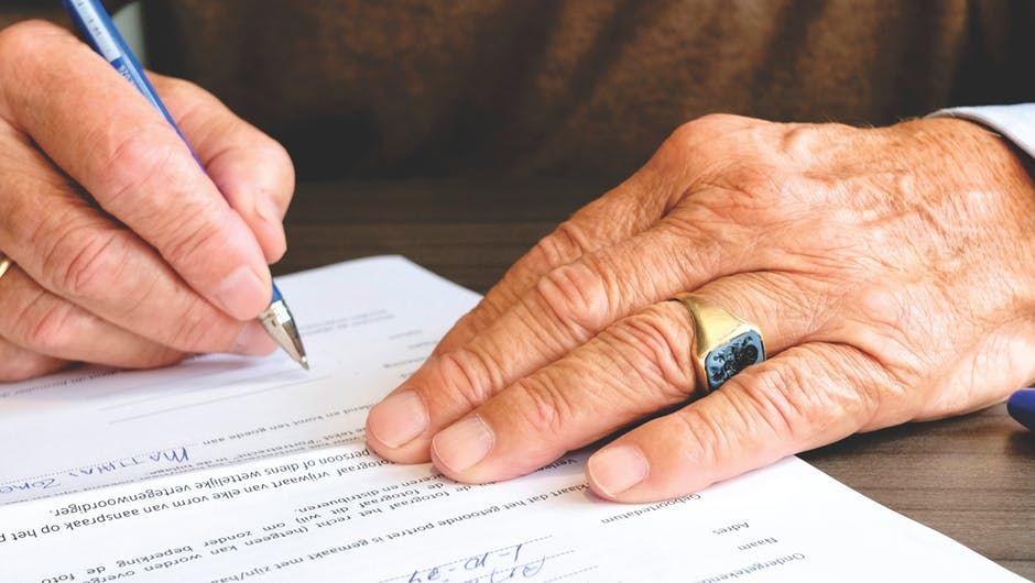 Person Signing Document Paper for computer research