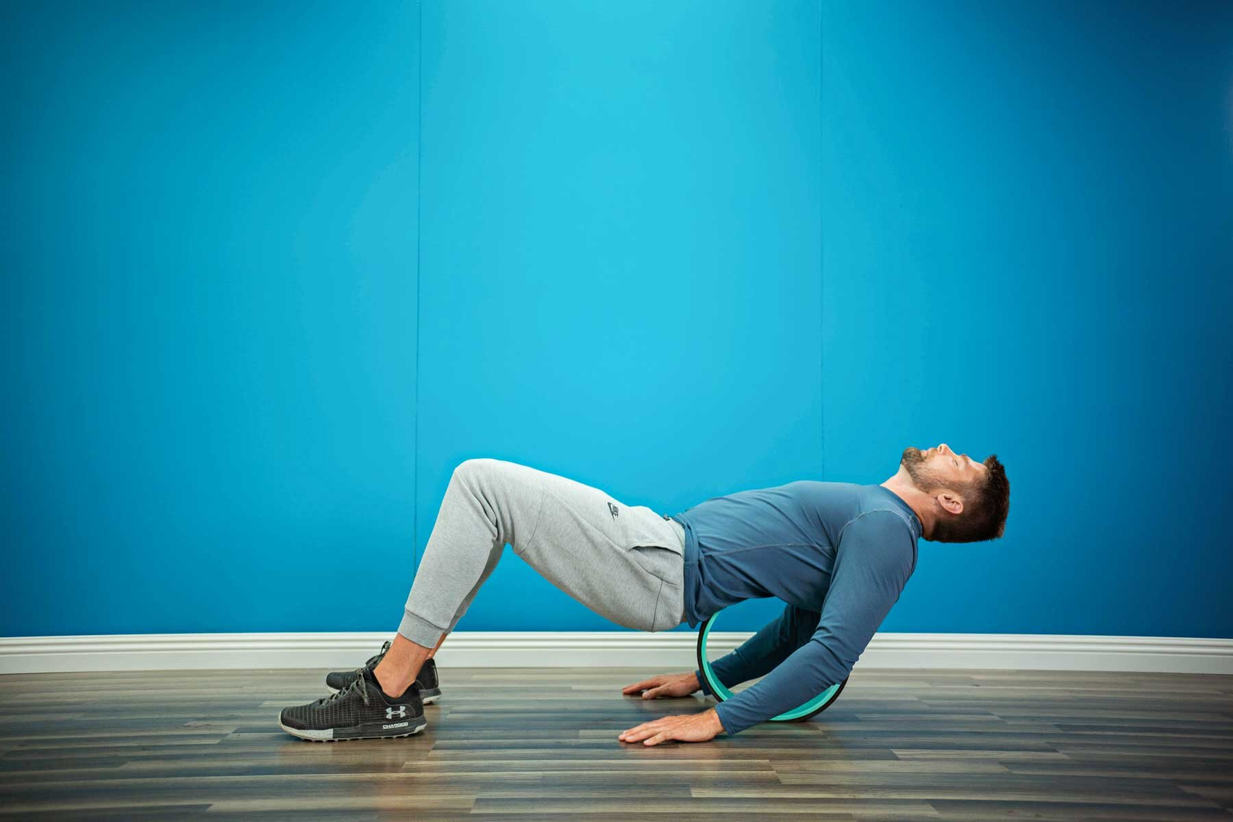 Man using Chirp Wheel device to stretch his back