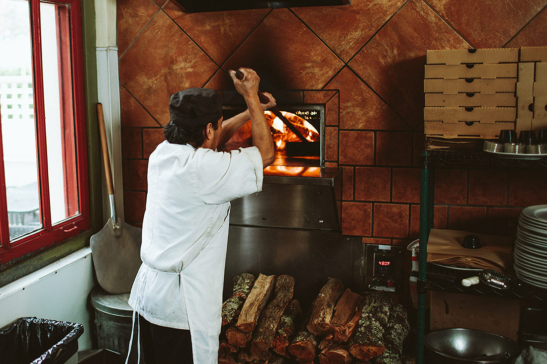 Cooking pizza in a wood-fired oven
