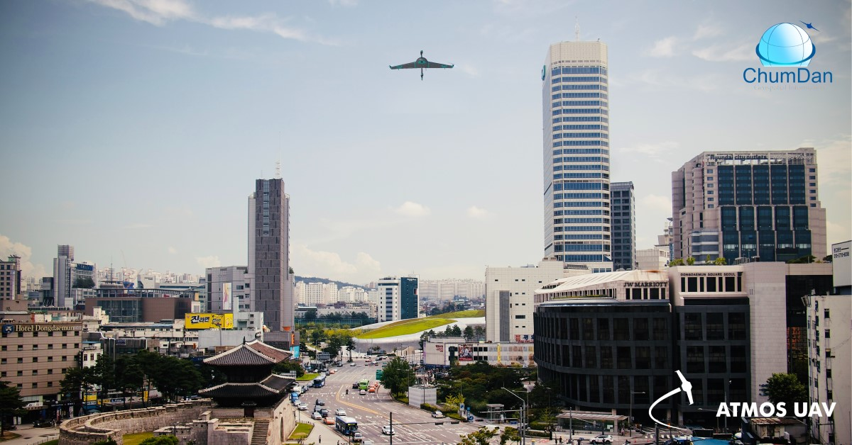 Illustration of the Marlyn VTOL Fixed-Wing Drone flying over Seoul (Korea)