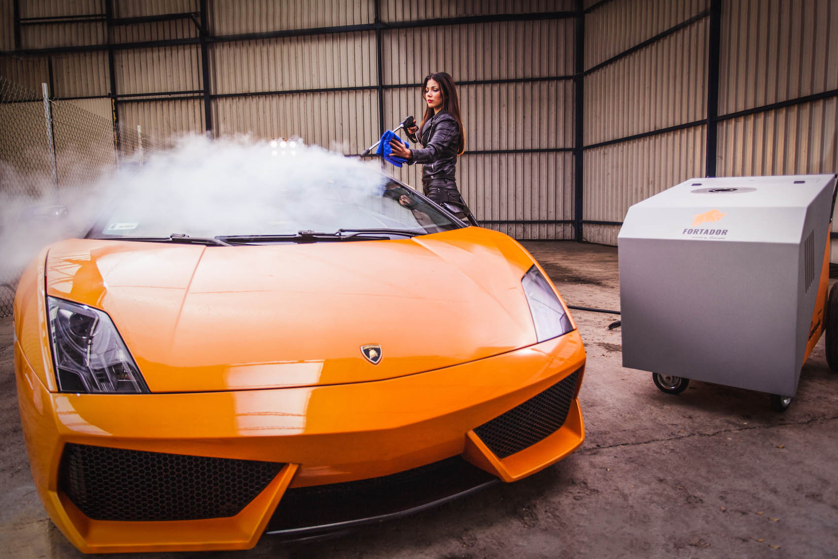 Fortador car wash steam cleaner working on a lamborghini.