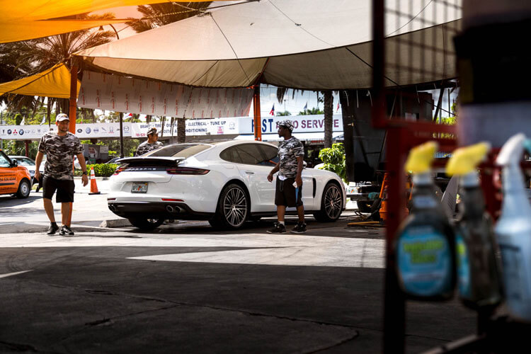 Detailers working at a car wash