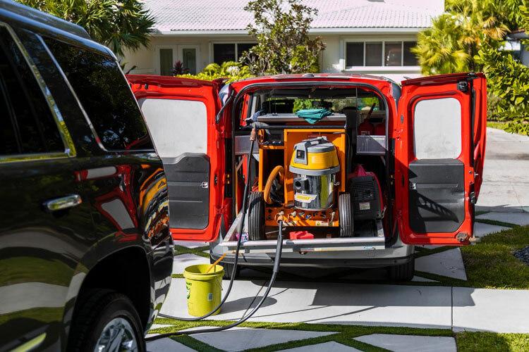Fortador car wash steam cleaner in van.