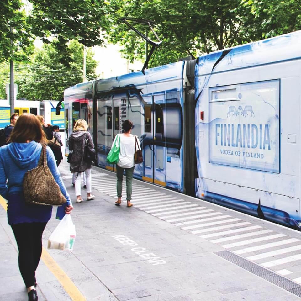 Finlandia tram picking up passengers in Melbourne CBD