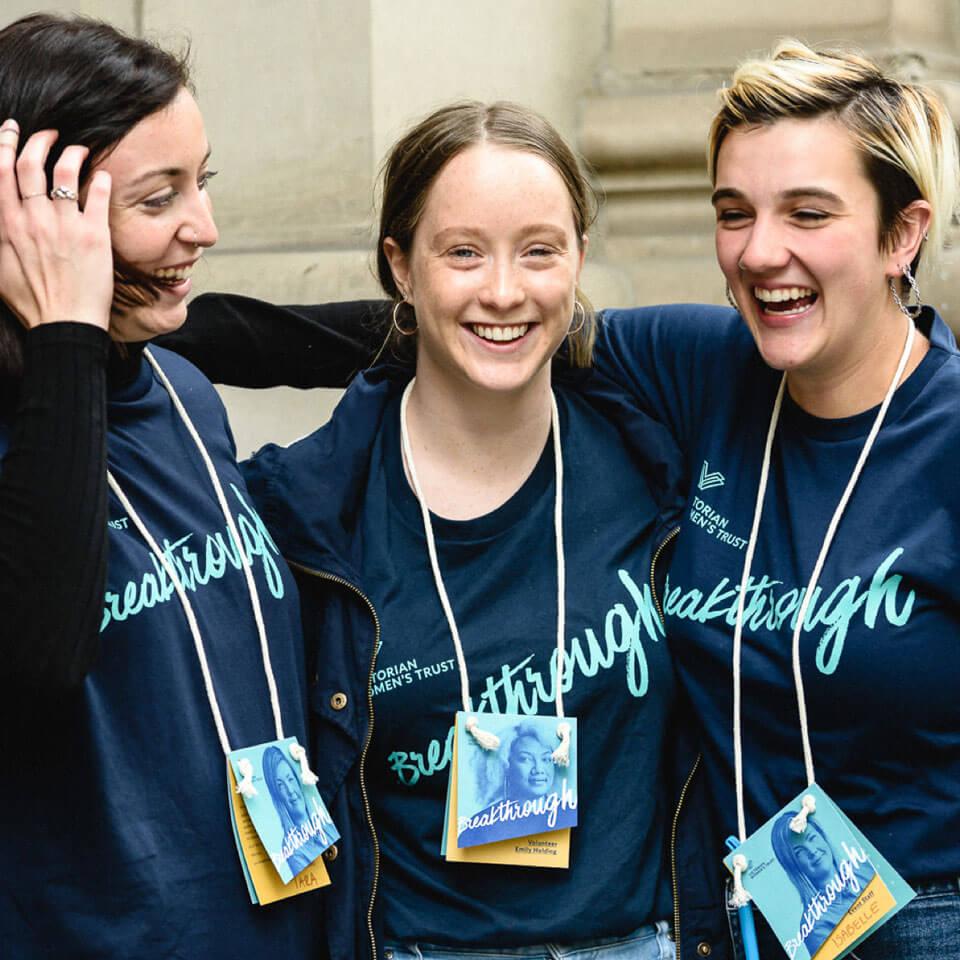 Breakthrough volunteers in branded tshirts and lanyards.