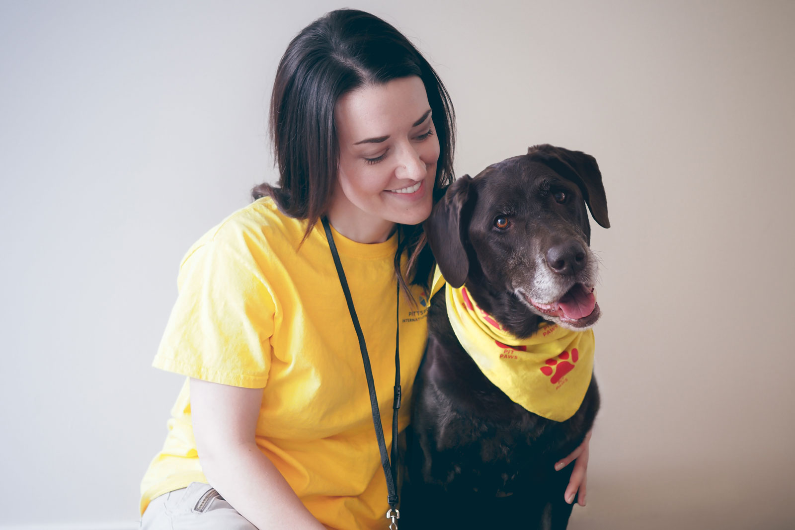 Tara Hoover and her Chocolate Lab Juno work as a therapy dog team