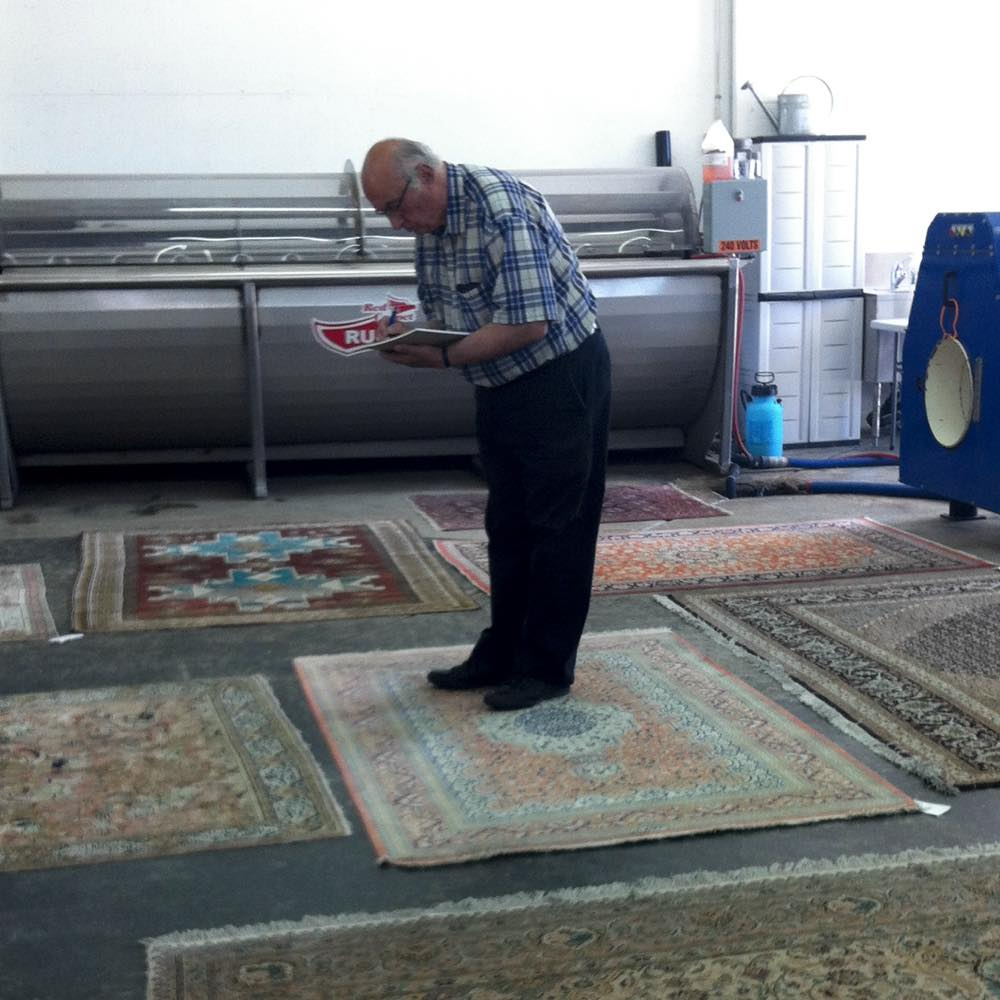 Area Rug Being Raised By Red Carpet Spa Expert
