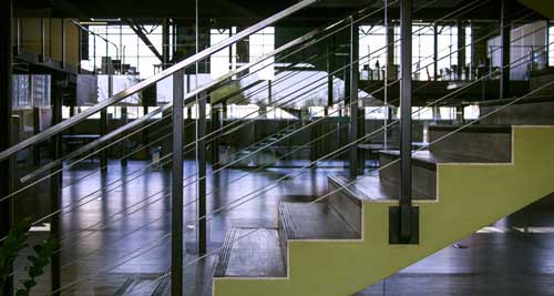 office staircase with glass and steel railing