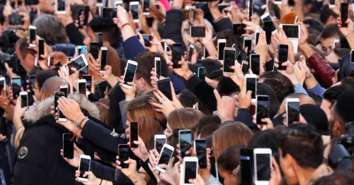 Image of crowd holding up phones