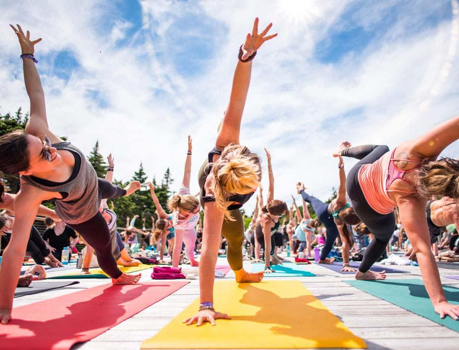 Attendees Doing Yoga At Wanderlust Festival