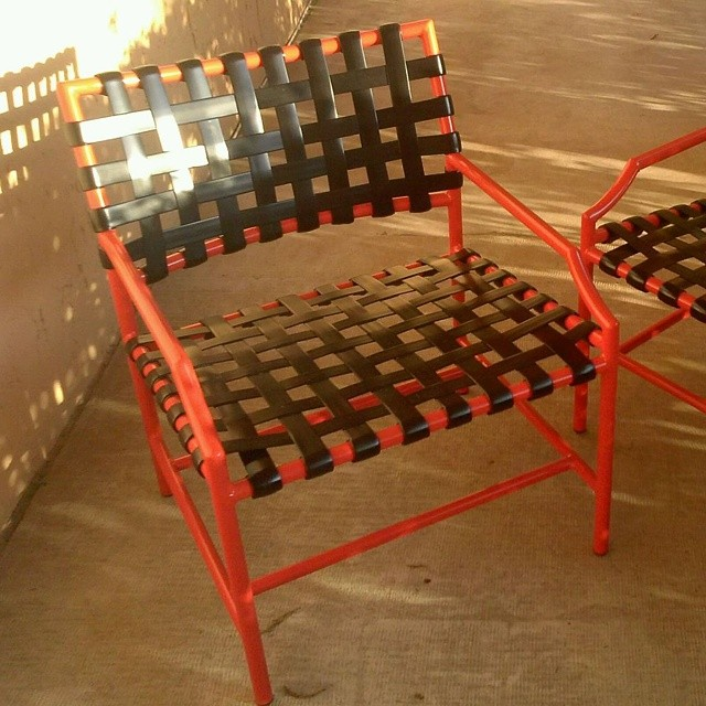Powder coated and restrapped orange and black chair