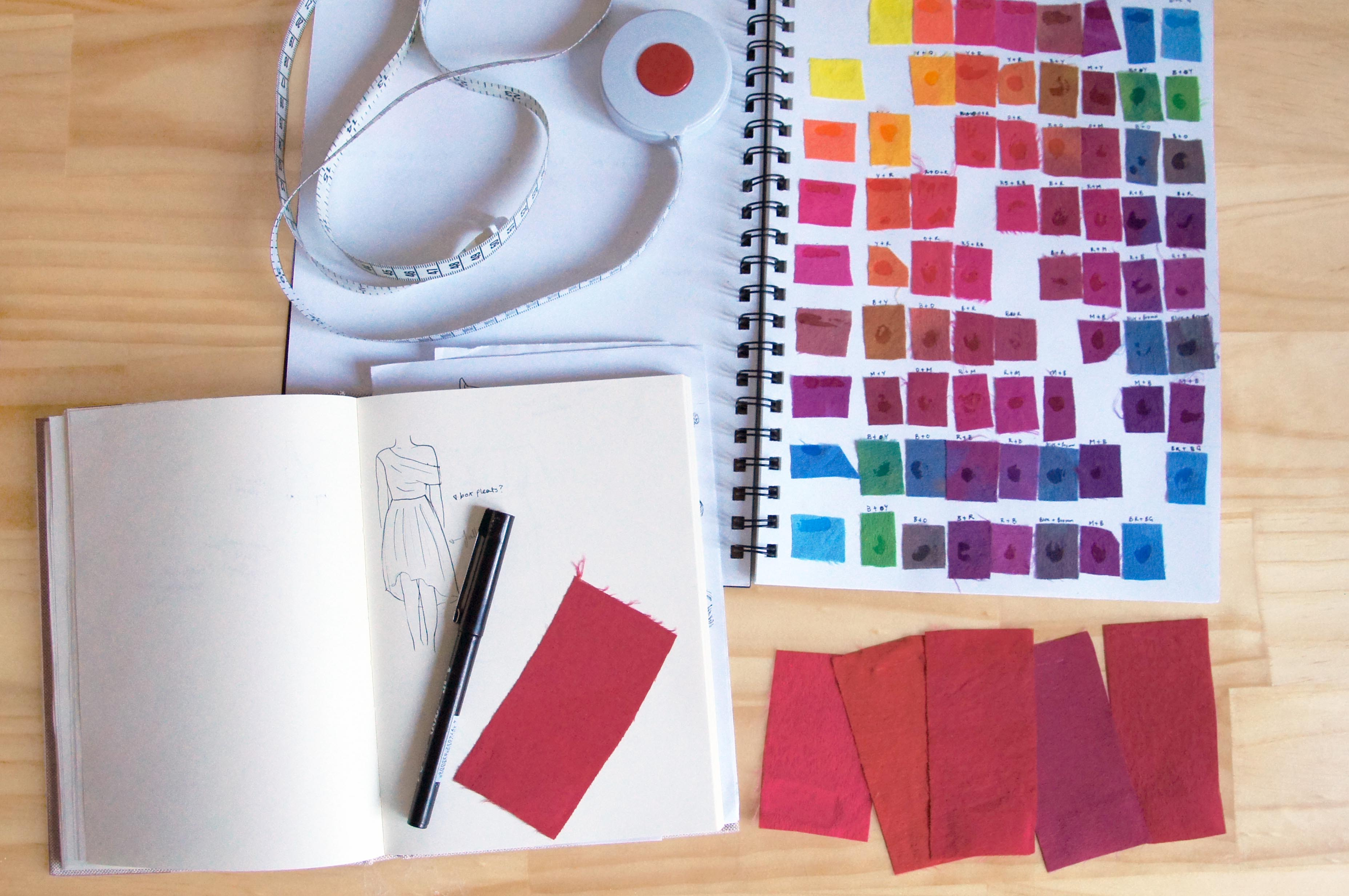 photo of fabric swatches and design sketch book