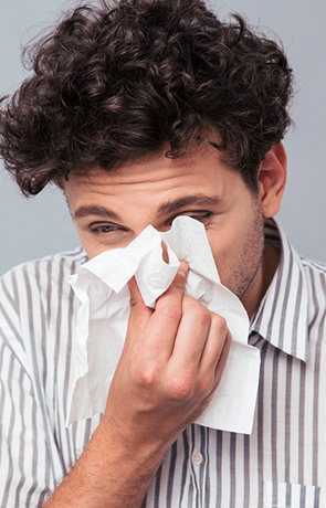 Man suffering from severe sinus pain