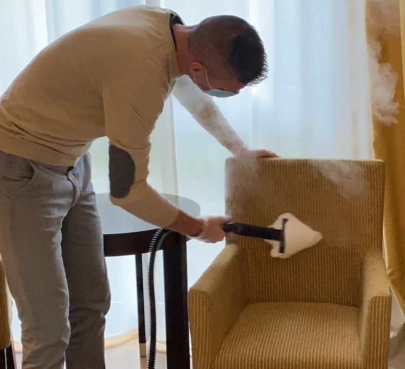 cleaning of chair with small steamer