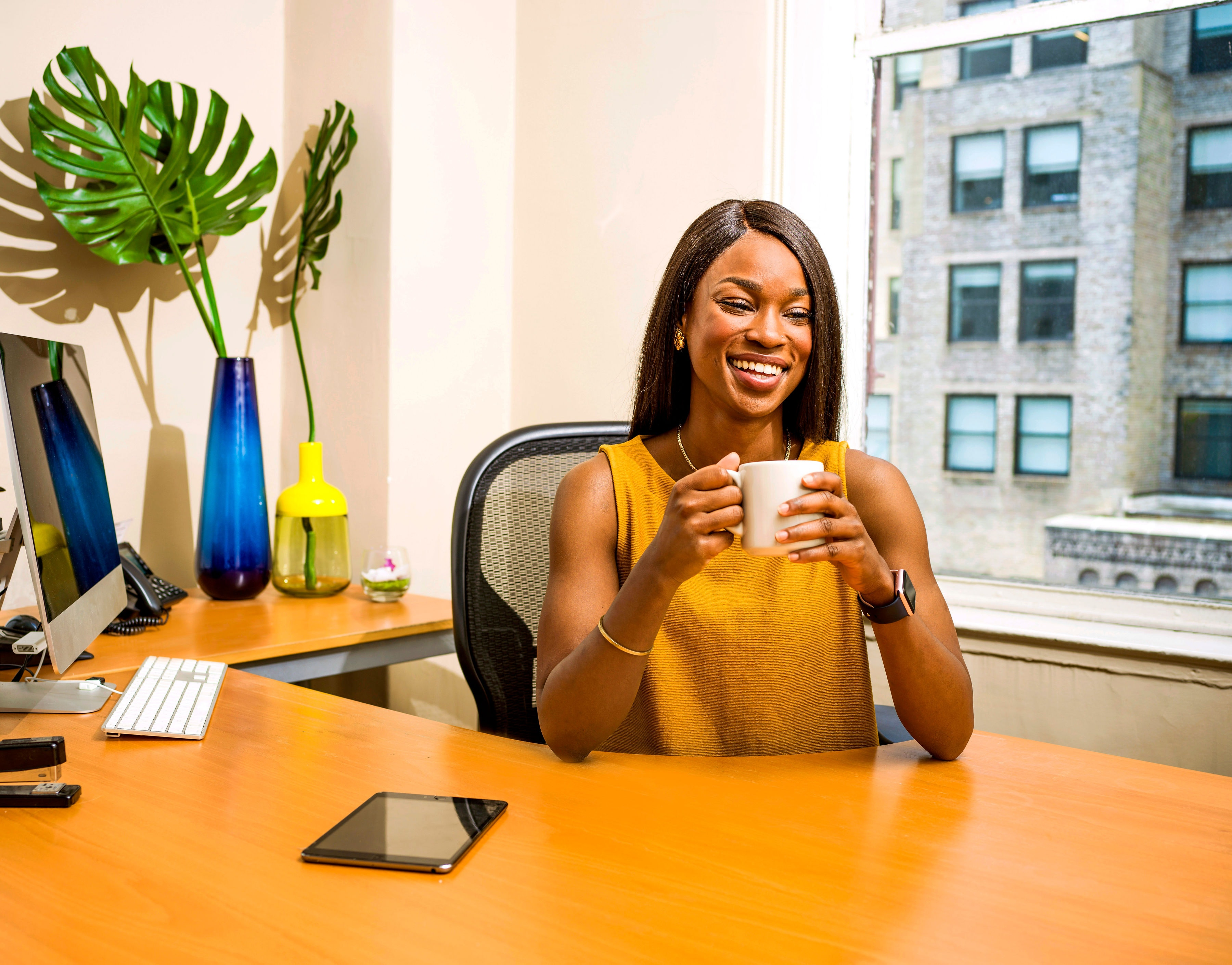 Black business women smiling because she is using EXOD the automated Facebook marketing platform.