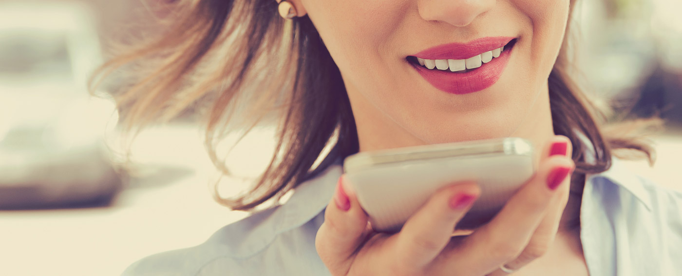 Woman talking into an iPhone