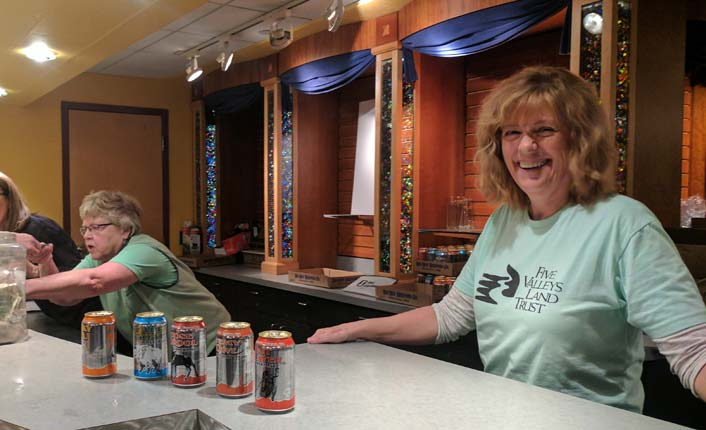 A Five Valleys volunteer at the Big Sky Brewing beer bar.