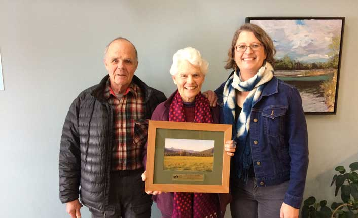 Landowners Elon Gilbert and Susie Miller and Five Valleys' Pelah Hoyt at the easement's finalization celebration. Photo by Five Valleys staff.