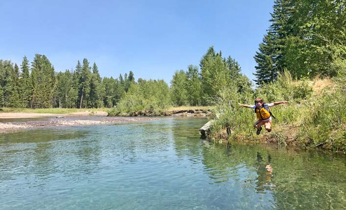 Swimming in the Blackfoot River at the Lincoln Community River Park. Photo by Five Valleys staff.
