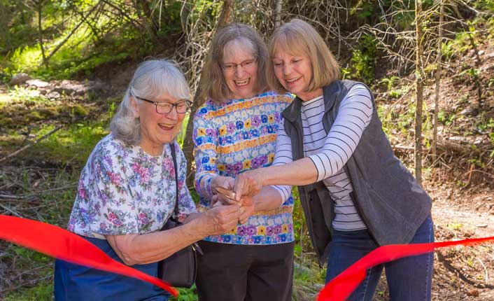 The Barmeyer family cutting the ribbon on the new Barmeyer Trail. Photo by Vo Von Sehlen.