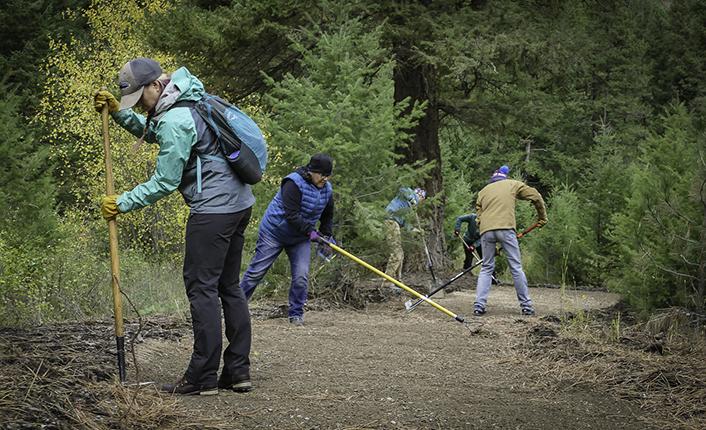 Volunteers building the universal trail along Miller Creek.