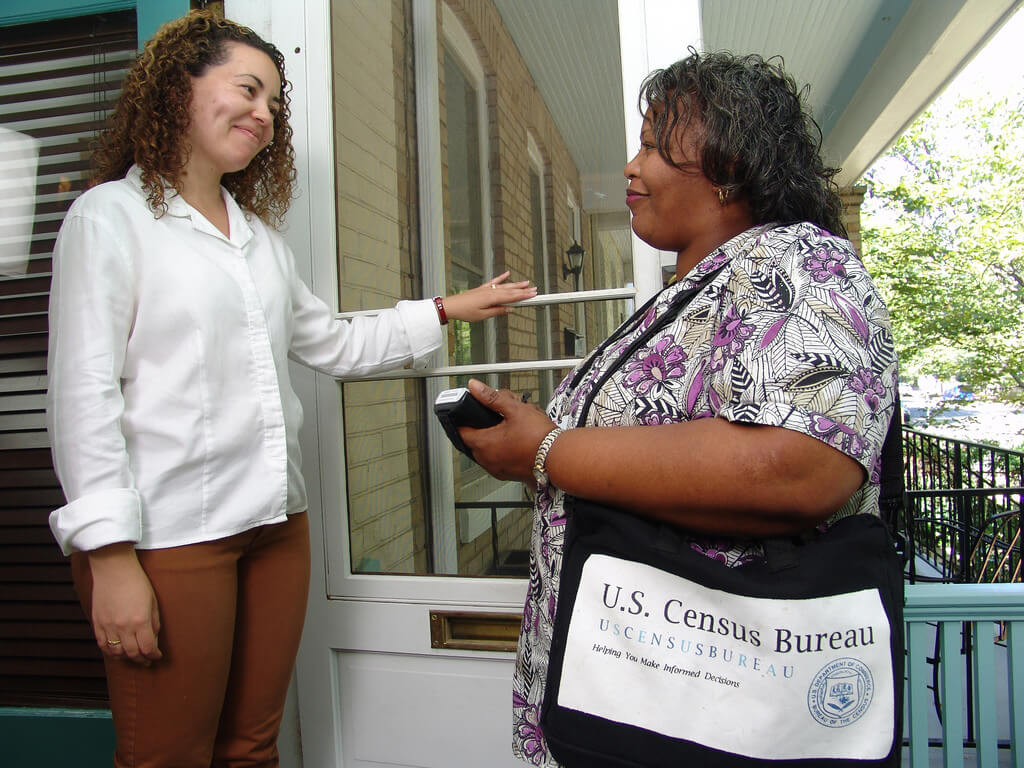 U.S. Census Enumerator surveying neighborhood