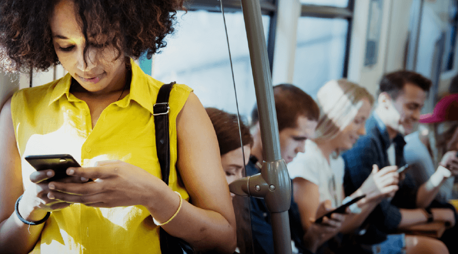 woman texting on the bus