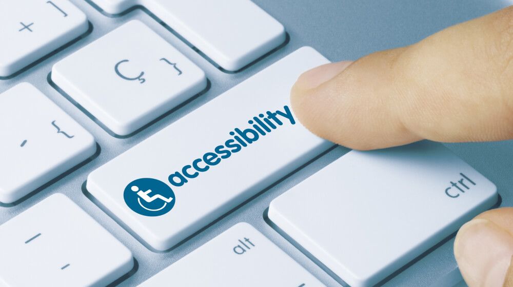 """Finger pressing key on a computer keyboard saying """"accessibility"""""""