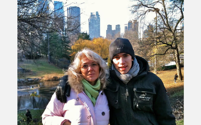Milena and her son share a hug in Central Park on a sunny winter's day.
