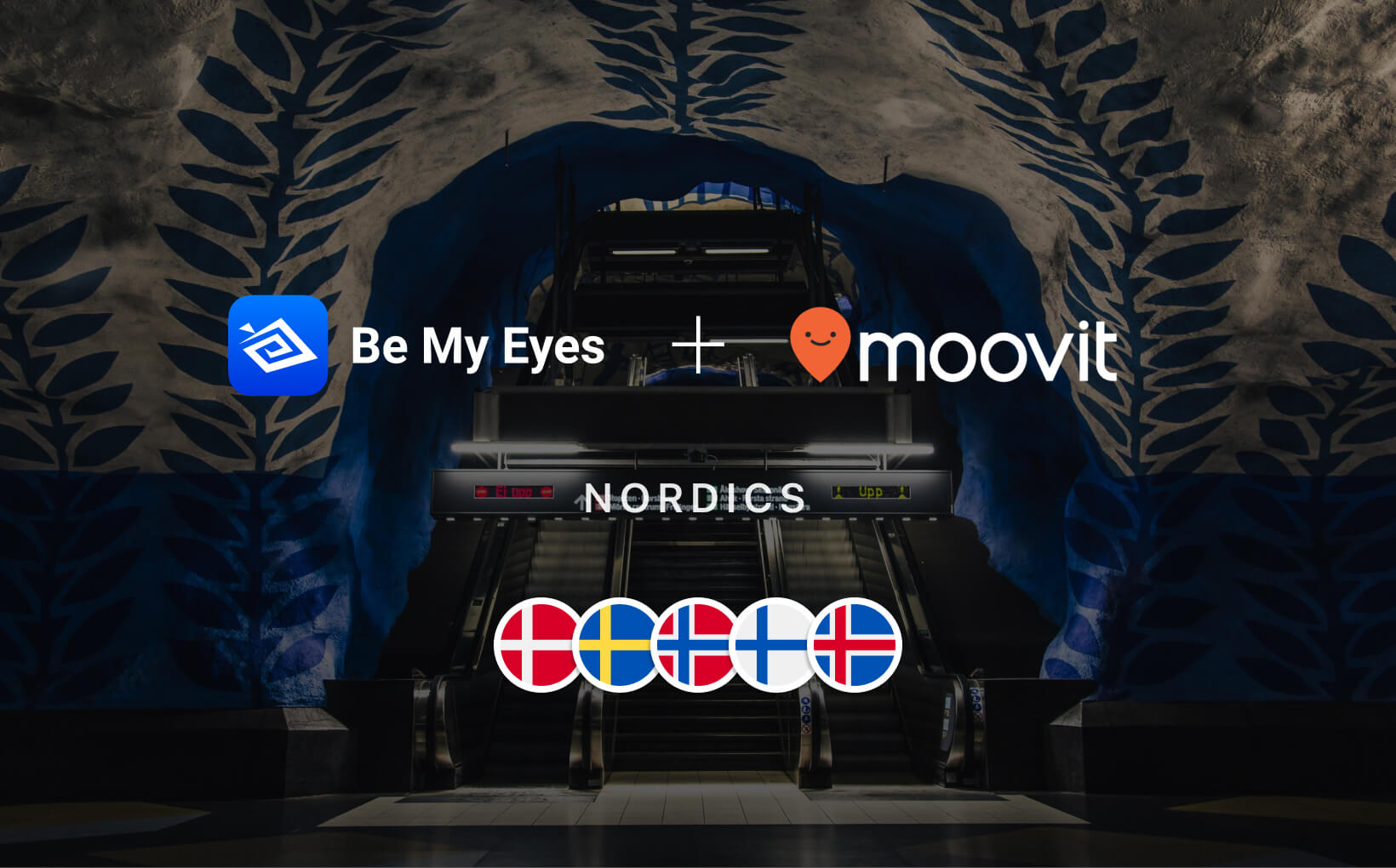 "Picture from T-Centralen Metro Station in Stockholm. Across is written ""Nordics"" along with the flag icons of Denmark, Sweden, Norway, Finland and Iceland, as well as ""Be My Eyes + Moovit"" along with the two logos of the companies."