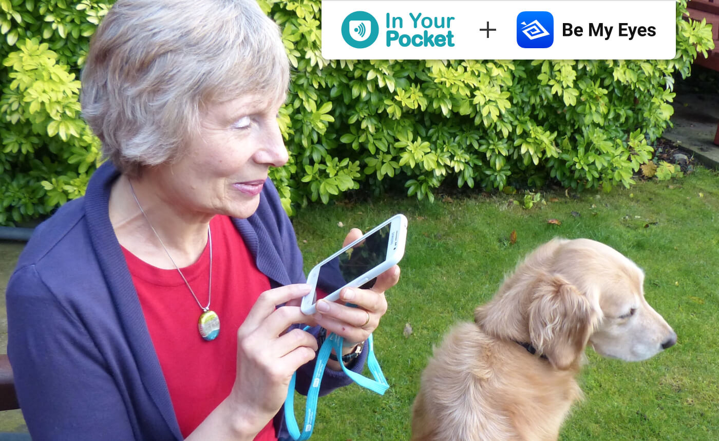 "Woman uses the In Your Pocket phone. She is in her garden with her dog. In the top right corner the picture says: ""In Your Pocket + Be My Eyes""."