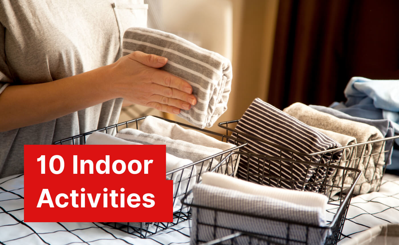 """Woman folding clothes Marie Kondo style and organizing them in baskets. Text reads: """"10 indoor activities""""."""