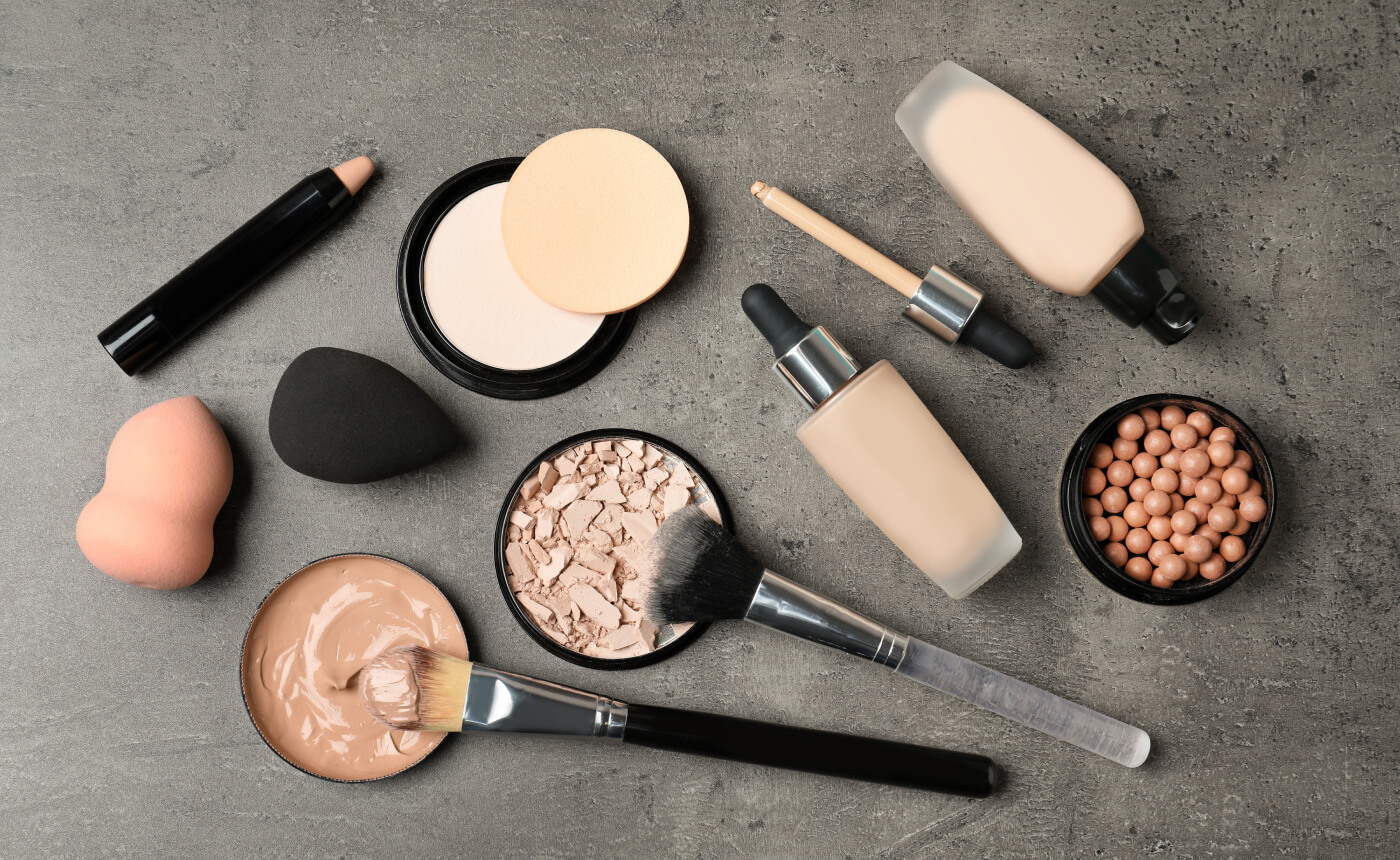 An assortment of complexion makeup supplies, brushes and sponges.