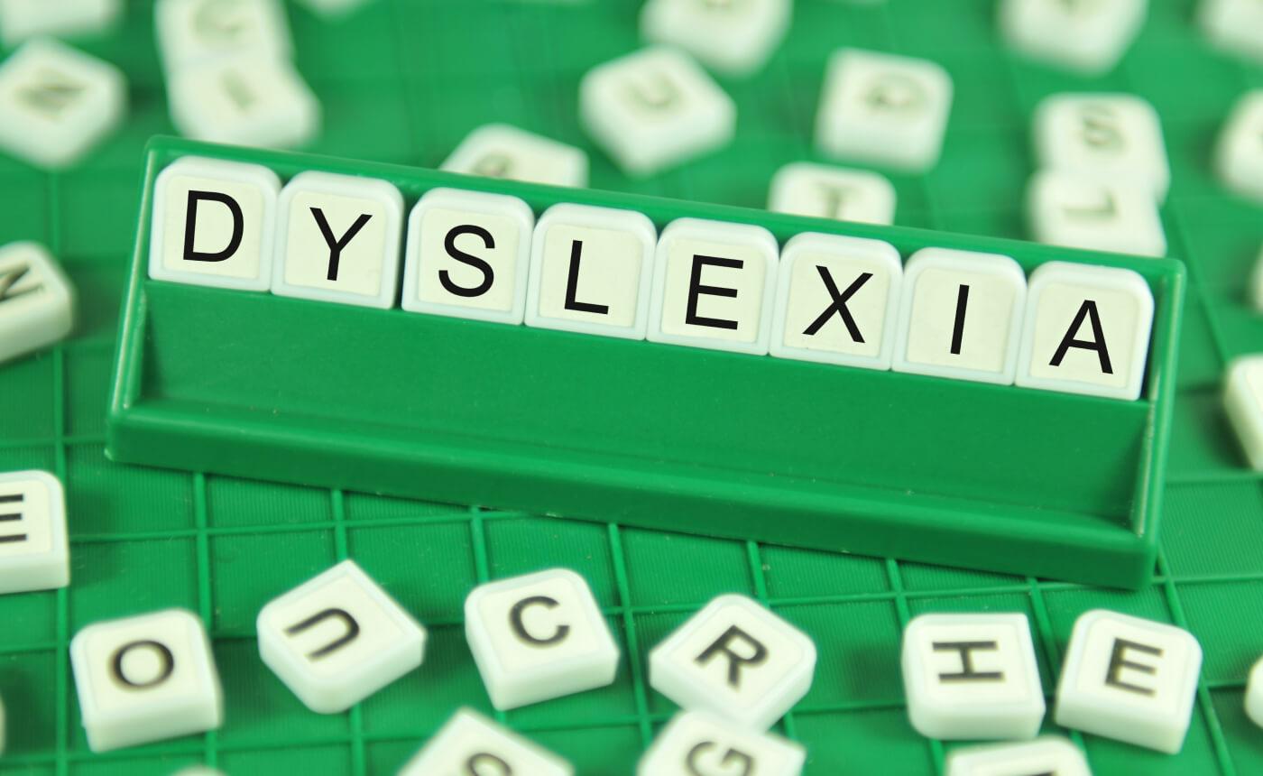 """The word """"Dyslexia"""" written in Scrabble tiles."""