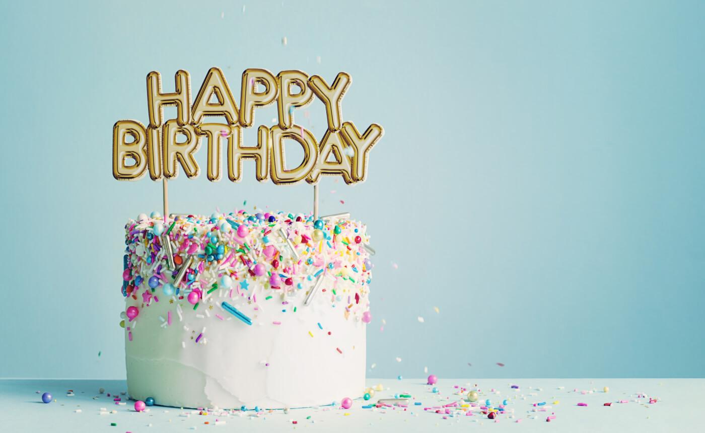 "Birthday cake with decoration saying ""Happy Birthday""."