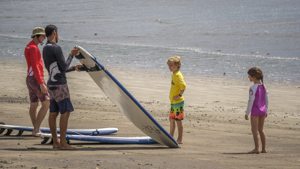 Two children get ready for class on their family surf camp.