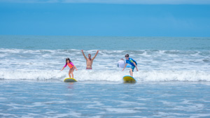 A young surfer gets a great ride on his family surf holiday.