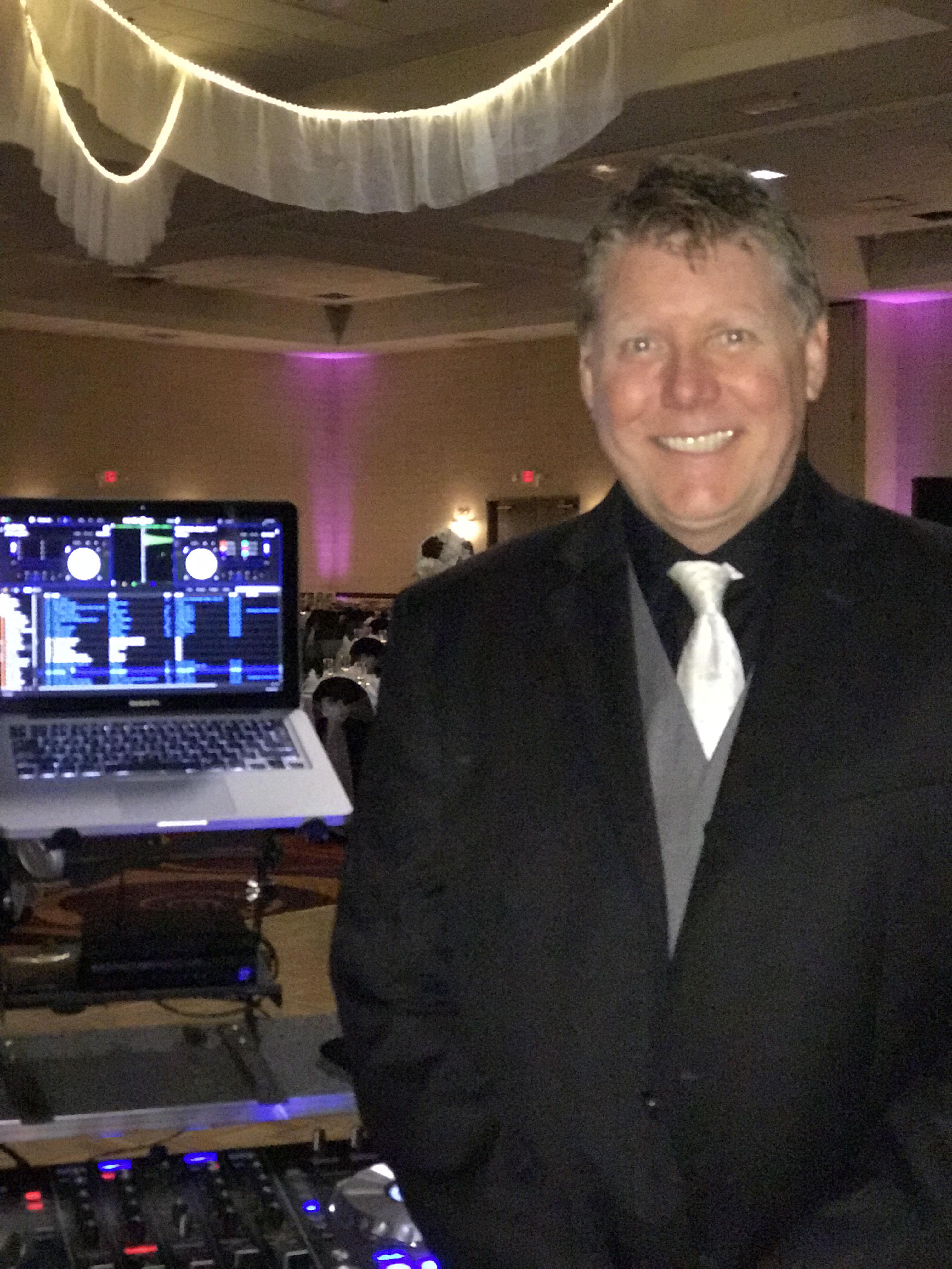 dj standing in front of equipment