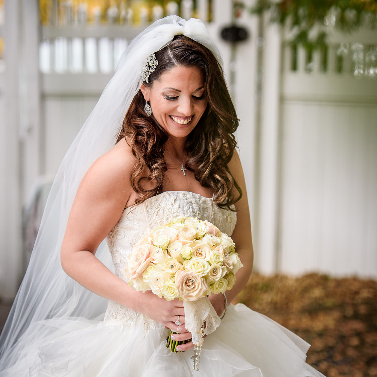 Bride looking down holding flowers